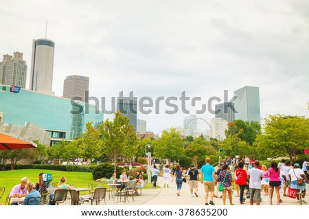 ATLANTA - AUGUST 29: World of Coca-Cola in Centennial Olympic park with people on August 29, 2015 in Atlanta, GA. - stock photo