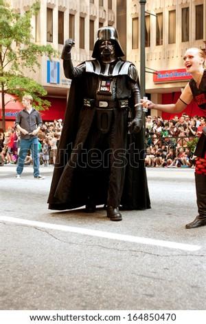 ATLANTA, GA - AUGUST 31:  A Darth Vader character walks down Peachtree Street in the annual Dragon Con parade in Atlanta, on August 31, 2013 in Atlanta, GA.  - stock photo