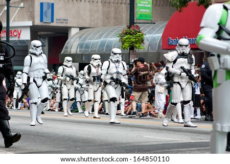 ATLANTA, GA - AUGUST 31:  A group of Star Wars storm troopers walks by spectators at the annual Dragon Con parade on Peachtree Street, on August 31, 2013 in Atlanta, GA.   - stock photo