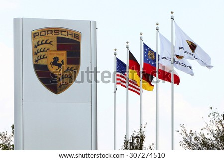 ATLANTA, GA-AUGUST, 2015:  Sign and flags in front of the USA headquarters for Porsche.  The newly constructed campus also includes a driving track. - stock photo