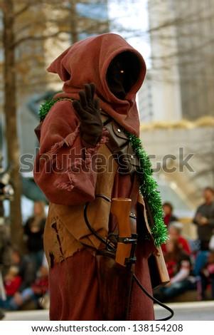 ATLANTA, GA - DECEMBER 1:  A Jawa character from the Star Wars movies walks down Peachtree Street while taking part in the annual Atlanta Christmas parade on December 1, 2012 in Atlanta, GA. - stock photo