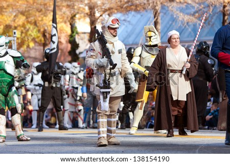 ATLANTA, GA - DECEMBER 1:  Characters from the Star Wars movies walk down Peachtree Street while taking part in the annual Atlanta Christmas parade on December 1, 2012 in Atlanta, GA. - stock photo