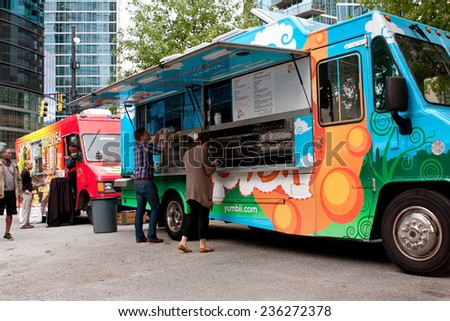 "ATLANTA, GA - OCTOBER 16:  Customers order meals from a popular food truck during their lunch hour, at ""Food Truck Thursday"" on October 16, 2014 in Atlanta. - stock photo"