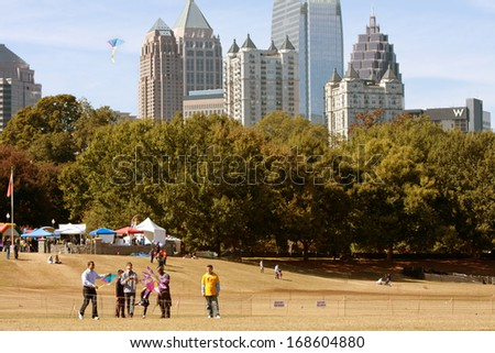 ATLANTA, GA - OCTOBER 26:  People fly kites in the World Kite Festival, at Piedmont Park on October 26, 2013 in Atlanta, GA.  The event was free and open to the public.   - stock photo