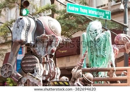 ATLANTA, GA - SEPTEMBER 5:  Science fiction creatures scare spectators at the annual Dragon Con Parade on Peachtree Street on September 5, 2015 in Atlanta, GA.  - stock photo