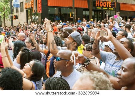 ATLANTA, GA - SEPTEMBER 5: Thousands of people gathered on Peachtree Street watch the annual Dragon Con parade on September 5, 2015 in Atlanta, GA.  - stock photo