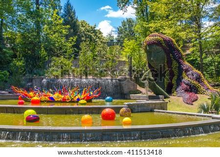 ATLANTA, GA, USA -  APRIL, 23 2016: Exhibition of glass artist Chihuly takes place in the Atlanta Botanical Garden in Atlanta, Georgia in 2016. - stock photo