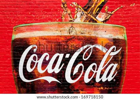 ATLANTA, GA, USA - DECEMBER 04: A glass full of Coca Cola painted in a old wall in Atlanta, Georgia on dec 04, 2013. Atlanta is the home of Coca Cola. - stock photo