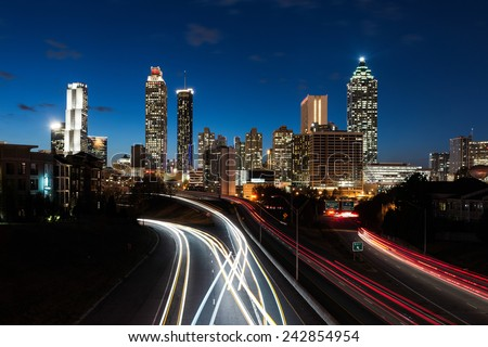 ATLANTA, GEORGIA - DECEMBER 2: Downtown Atlanta (east side) at dusk from the Jackson Street Bridge on December 2, 2014 in Atlanta, Georgia - stock photo