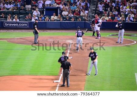 ATLANTA, GEORGIA - JUNE 16: Mets hit a homerun at Turner Field during a game between the Atlanta Braves and New York Mets June 16, 2011 in Atlanta, Georgia. - stock photo