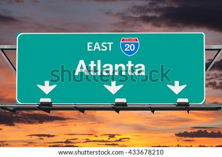 Atlanta Interstate 20 east highway sign with sunrise sky. - stock photo