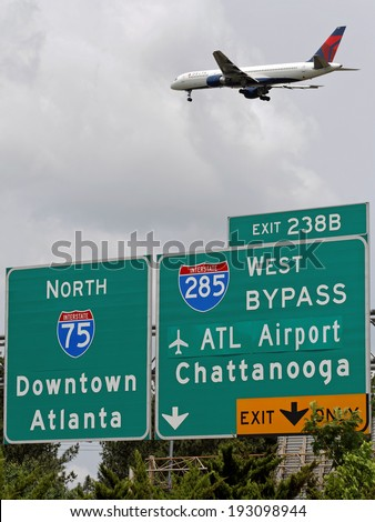 ATLANTA � MAY 6: A Delta jet comes in for a landing at the Hartsfield-Jackson Atlanta International Airport on May 6, 2012. The airport is Delta�s largest hub and one of the world's busiest airports. - stock photo