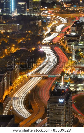 ATLANTA - SEPTEMBER 24: Interstate 85 winds through downtown September 24, 2011 in Atlanta, GA. Atlanta's infamous traffic puts the city near the top of most national lists ranking the worst commutes. - stock photo
