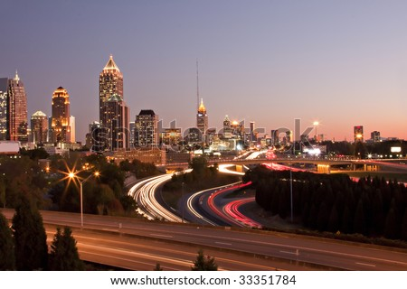 Atlanta skyline just before sunset showing downtown buildings, roads and traffic streaks. - stock photo