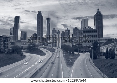 Atlanta. Toned image of Atlanta skyline and highway leading to the city. - stock photo