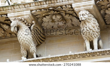 Atlantes at the Basilica of Santa Croce or Church of the Holy Cross, a famous baroque church in Lecce, a historic city in Apulia, Southern Italy.  - stock photo