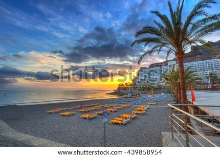 Atlantic beach of Gran Canaria island in Taurito at sunset, Spain - stock photo