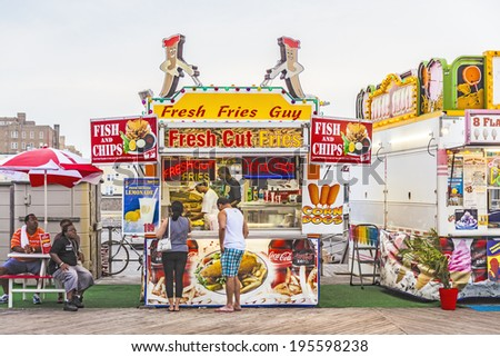 ATLANTIC CITY - JULY 13: people pay at the Fish and ships stand in  Atlantic City on July 13, 2010 in Atlantic City, USA. The town is  a nationally renowned resort city for gambling and shopping. - stock photo