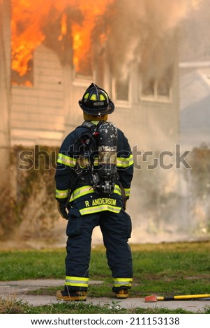 ATLANTIC CITY - July 18th: R. Anderson of the Atlantic City Fire Department responds to fire on North Providence Avenue  on July 18th 2014 in Atlantic City
