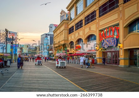 ATLANTIC CITY NEW JERSEY - SEPTEMBER 2: The boardwalk at sunset on September 2 2014 in Atlantic City New Jersey. - stock photo