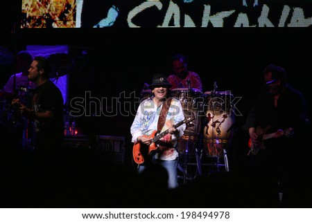 ATLANTIC CITY, NJ - JUNE 13: Musician Carlos Santana performs with his band at The Borgata Hotel & Casino on June 13, 2014 in Atlantic City, NJ.  - stock photo