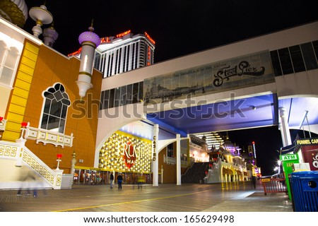 ATLANTIC CITY, NJ - SEPT 22: Trump Taj Mahal Casino Resort seen from the Atlantic City boardwalk NJ on the night of Sept 22, 2013. This boardwalk hotel opened in 1990.