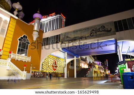ATLANTIC CITY, NJ - SEPT 22: Trump Taj Mahal Casino Resort seen from the Atlantic City boardwalk NJ on the night of Sept 22, 2013. This boardwalk hotel opened in 1990. - stock photo