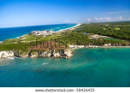 Atlantic ocean and unfinished residence from helicopter view, Dominican Republic