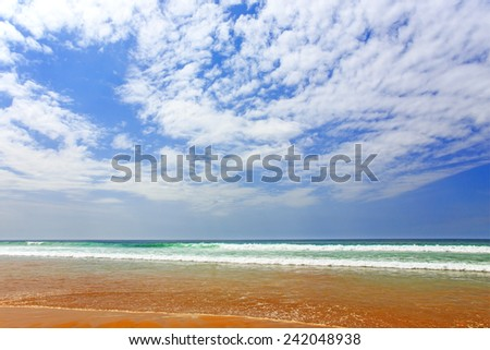 Atlantic Ocean, blue sky and small clouds in Agadir, Morocco - stock photo