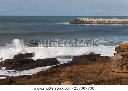 Atlantic ocean coast and breakwater at Ericeira village, Portugal, Europe. - stock photo
