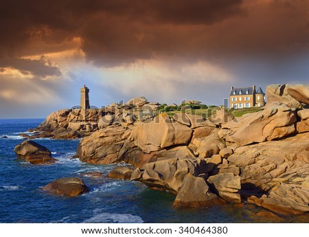 Atlantic ocean coast in Brittany near Ploumanach, France. The Pink Granite Coast, so-called because of the colour of its rocks, is one of the most beautiful stretches of Brittanyâ??s coastline. - stock photo