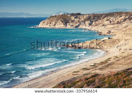 Atlantic Ocean coast in summer. Coastal landscape of Gibraltar strait, Morocco. Soft tonal correction photo filter effect - stock photo