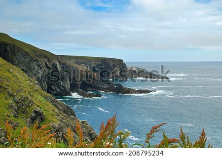 Atlantic ocean coast with cliffs at Mizen Head, County Cork, Ireland - stock photo