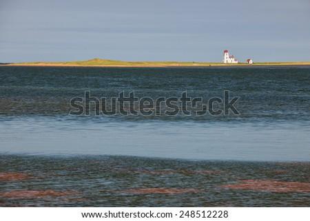 Atlantic ocean landscape with Cascumpec Sandhill lighthouse in Prince Edward Island, Canada - stock photo