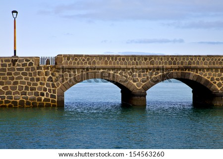 atlantic ocean lanzarote  bridge and in the blue sky   arrecife teguise spain