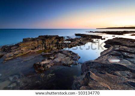 Atlantic ocean scenery at amazing sunset, Ireland - stock photo