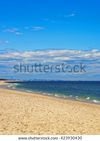 Atlantic Ocean shore at Sandy Hook with a view of NYC. Sandy Hook is in New Jersey, USA.  - stock photo