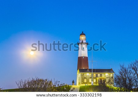 Atlantic ocean waves on the beach at Montauk Point Light, Lighthouse, Long Island, New York, Suffolk County - stock photo