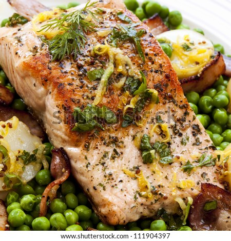 Atlantic salmon, grilled with bacon, lemon zest, parsley and dill.  Served with new potatoes and peas.