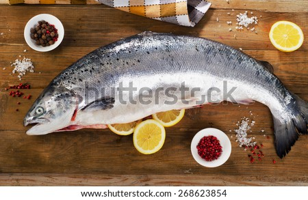 Atlantic Salmon  with lemon on a wooden board. Top view - stock photo