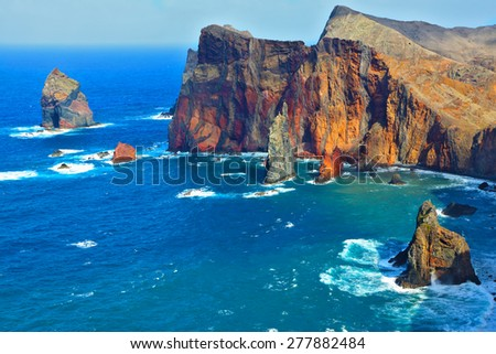 Atlantic storms. Arid eastern tip of the island of Madeira. Colorful pinnacles lit sunset  - stock photo