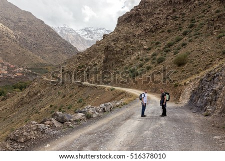 Atlas Mountains, Morocco, circa November 2016. Tourists on their way through a valley to Jabal Toubkal pick.