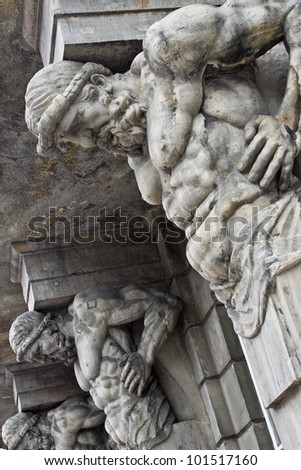 Atlases as a detail of building exterior - stock photo