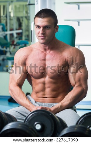 Atlet the gym to workout. Doing exercises for the muscles of the body. Grueling workout. Photos for sporting magazines and websites.  - stock photo