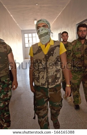 ATME, SYRIA -  JUNE  18 2012 - Unidentified rebel of the Free Syrian Army in rebel controlled building on June  18, 2012 in Atme, Syria, - stock photo