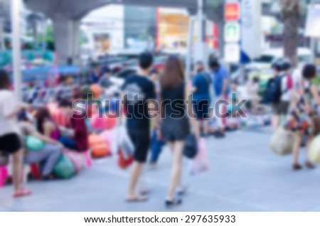 atmosphere around people walking the streets blur background