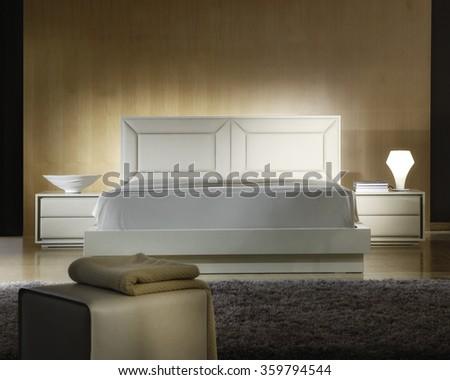 ATMOSPHERIC BEDROOM INTERIOR . WHITE LEATHER BED . - stock photo