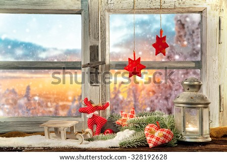 Atmospheric Christmas window sill decoration with beautiful sunset view - stock photo