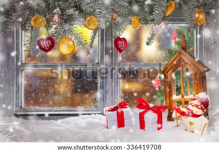 Atmospheric Christmas window sill decoration with home cozy interior.