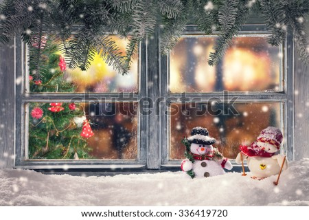 Atmospheric Christmas window sill decoration with home cozy interior. Christmas tree on background - stock photo